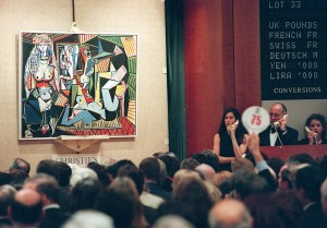 "An unidentified person holding numbered paddle makes a bid on Pablo Picasso's painting, ""Les femmes d'Alger"" 10 November in New York at Christie's auction house. The painting sold for 31.9 million USD and was one of 58 pieces of 20th century art offered for sale from the collection of Victor and Sally Ganz. At right, Christie's employees take telephone bids. AFP PHOTO/Stan HONDA        (Photo credit should read STAN HONDA/AFP/Getty Images)"